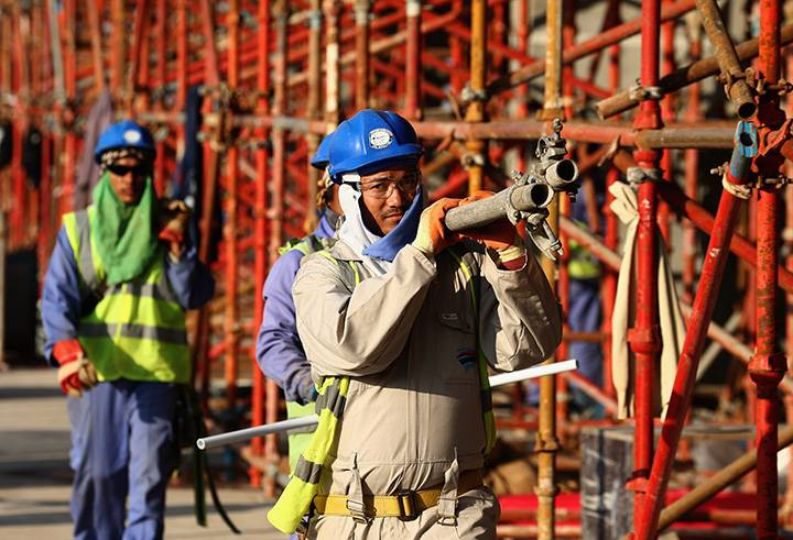 C:\Users\Morteza\Desktop\جام جهانی و وضعیت کارگران\Construction workers on Khalifa International Stadium ahead of the 2022 FIFA World Cup Qatar on December 30, 2015 in Doha,.jpg